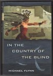 In the Country of the Blind by Michael Flynn (First Edition)